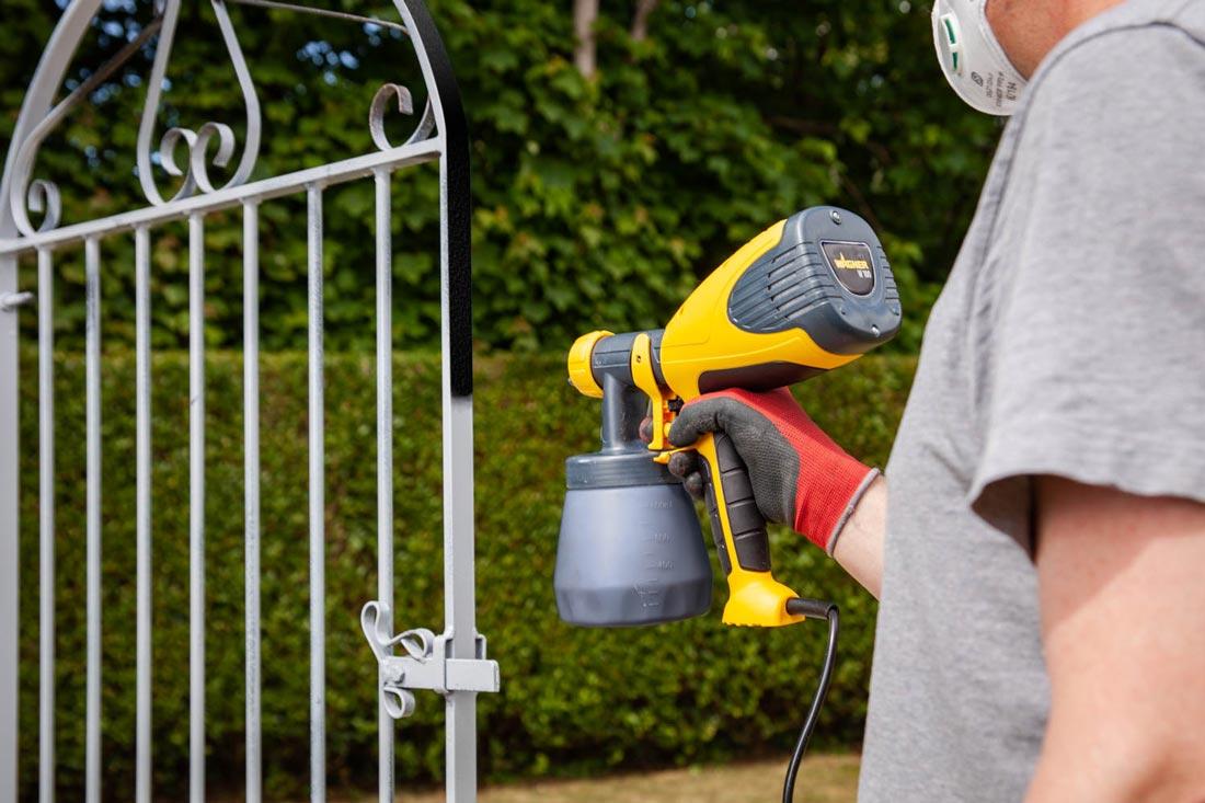 W100 HVLP spray paint garden gate