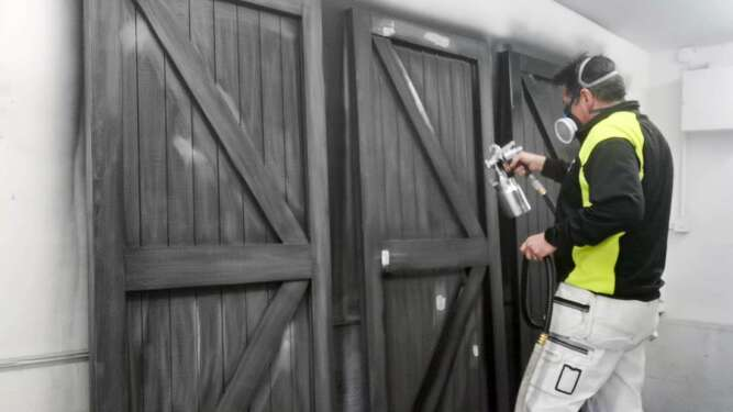 Paintshack spray painting Garage Ledge & Brace doors with a Wagner FC9900 HVLP paint sprayer
